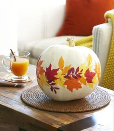 Lawn-gathered leaves that were traced onto orange, yellow, and dark red tissue paper give this pumpkin its graphic look. Learn more at Good Housekeeping. - CountryLiving.com