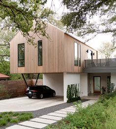 Toying with a conventional form, an architect designs a modern house meant for alfresco entertaining. Toying with a conventional form, an architect designs a modern house meant for alfresco entertaining. House Cladding, Facade House, Brick Facade, Gable House, Gable Roof, Modern Small House Design, Minimalist Architecture, Contemporary Architecture, Residential Architecture