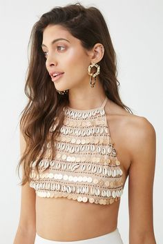 This woven top is embellished with hanging cowrie shells and high-polish coin charms, a high halter neckline with self-tie cami straps, a self-tie back strap, and a cropped hem. Kids Blouse Designs, Choli Designs, Kurta Designs, Samba, Afro, Dress Indian Style, Indian Wear, Sleeves Designs For Dresses, Stylish Blouse Design