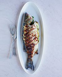 """Grilled Whole Fish Recipe on Food & Wine  ~  Dave Pasternack lets fish come to room temperature and dries it well before grilling. """"An ice-cold fish gives off steam, making the skin stick to the grill,"""" he explains"""