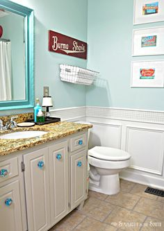 Sherwin Williams Tidewater Turquoise Bathroom---- I like the darker mirror trim from wall paint