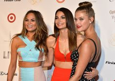 Chrissy Teigen Photos Photos - (L-R) Models Chrissy Teigen, Lily Aldridge, and Nina Agdal attend Club SI Swimsuit at LIV Nightclub hosted by Sports Illustrated at Fontainebleau Miami on February 19, 2014 in Miami Beach, Florida. - Sports Illustrated Hosts Club SI Swimsuit Bash