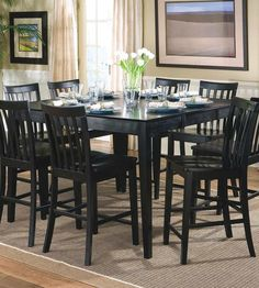 counter height bar stools give an awesome bar look in a kitchen and dining room: rustic dark wooden counter height bar stools with square dining table on chocolate rug set in the middle