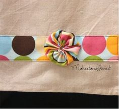 Ashley Johnston ofMake It andLove It shares how she ties colors together in her kitchen with a stripe of fabric sewn onto plain tea towels. This is an easy sewing project for gift-giving, such as for Mother's Day. Use holiday fabric for holiday tea towels. Use this tutorial to create a cute fabric yo-yo embellishment. @ http://www.favecrafts.com/Home-Decor/Embellish-a-Tea-Towel