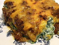 """Mexican Spinach Lasagna"" This dish is a staple at our house. It's quite simple to have all of the ingredients on hand -- the key is to remember to get your ground beef thawed, and your spinach as well, so the ingredients will be ready when you are.  ** Are you a low carb dieter? http://www.ketolaughs.com has tshirts, mugs, and more to fit YOUR life and sense of humor."