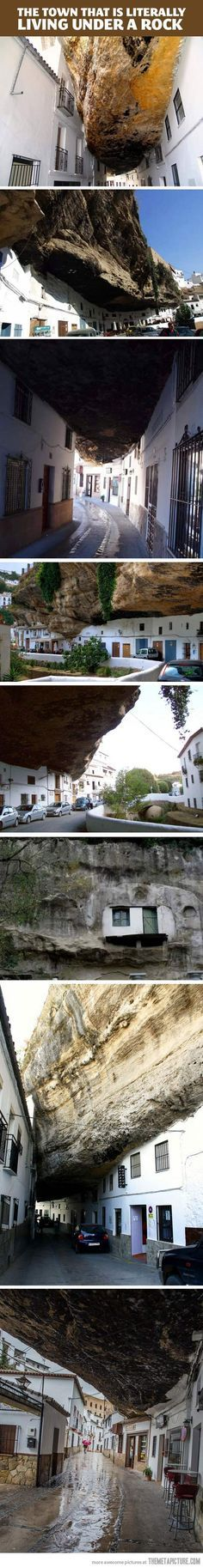 The small town of Setenil de las Bodegas is home to around 3,000 people. The Andalucian town, northeast of Cadiz, Spain, was built along a narrow river gorge eroded by the Rio Trejo river. Many of the houses are built into & under the walls of the gorge itself, a tradition which has dated back to pre-historic times. They can live in the gnarled caves & just construct a façade. It's perfect for blocking the hot & cold temperatures that sweep the country.