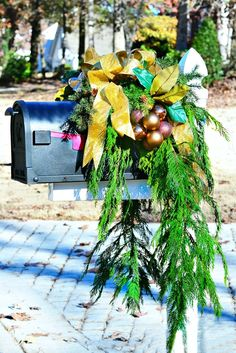 How To Decorate Your Mailbox for the Holidays --> http://www.hgtvgardens.com/christmas/mailbox-decorating-for-the-holidays?soc=pinterest