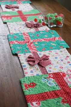 Sewing Quilts Christmas Table Runner More - How's a big stack of gifts for some holiday cheer! :) I've been putting off making holiday projects because, well, life has been so busy. But before I knew i… Table Runner Christmas, Christmas Placemats, Xmas Table Runners, Christmas Sewing Projects, Christmas Sewing Gifts, Crochet Christmas, Christmas Fabric Crafts, Christmas Patchwork, Purple Christmas