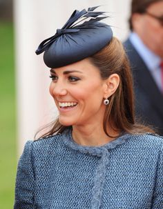 A sweet, bow-adorned Rachel Trevor-Morgan hat to match her tweed jacket during a visit to Vernon Park in 20...