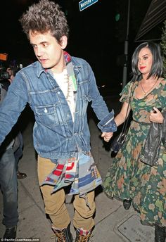 Still together: John Mayer was seen leading Katy Perry out of a restaurant in West Hollywood.