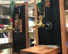 Items similar to Zig Zag Wine Rack, Rustic Wood Wine Bottle Display Wall Mounted on Etsy Wine Bottle Display, Wine Glass Holder, Wine Bottle Holders, Horseshoe Wine Rack, Whiskey Dispenser, Rustic Wine Racks, Stainless Steel Pipe, Liquor Bottles, Custom Wood
