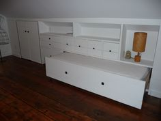 renovated attic bedroom with bed in a drawer. custom designed by LQ Interiors & Landscapes