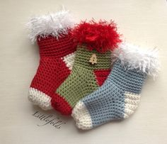 #freepattern #crochet Mini Christmas Stockings - what combination will you make? Join them together for bunting or an Advent calendar, hang them on the tree, the possibilities are endless. Have fun xx https://www.facebook.com/notes/littlefolds/mini-christmas-stocking/1627721527455218