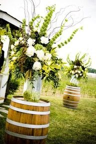 wedding floral arrangements on wine barrels - Google Search