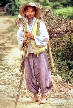"""Farmer (1976), South Korea by Tom Coyer. """"Even back in 1976, such a sight had become rare. This was taken just out side of Okcheon, Chungbuk."""" ~ What a proud-looking man. Hardworking and strong."""