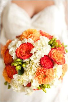 Orange & white with green touches, boquet for the bride.  The Return of Jewel Tones for Fall 2014