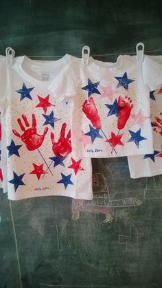 These are our 4th of July shirts for this year!  Handprints (footprints) are sparklers with yellow sparks falling around.