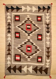 Google Image Result for http://charleysnavajorugs.com/assets/images/historic-navajo-rugs-for-sale/288-JB-Moore-crystal-trading-post-navajo-rug-53x80.jpg