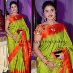 Parrot green color light weight silk saree with orange plain border, teamed up with lambada glass work orange color silk designer blouse ...