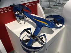 An interesting looking tricopter drone in blue on display.