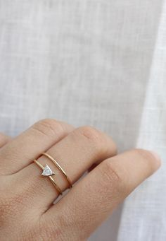 The unique and detailed cut of the Trillion Diamond shines bright when paired with our 14k yellow gold rings, always solid and never plated, filled or fake. | Vrai & Oro