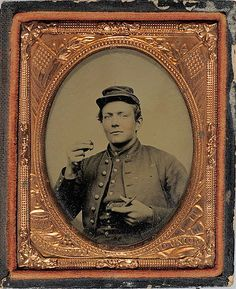 ca. 1860's, [ambrotype portrait of an unidentified private presenting two fingers of tobacco and preparing to indulge in a chew]  via Cowan's Auctions