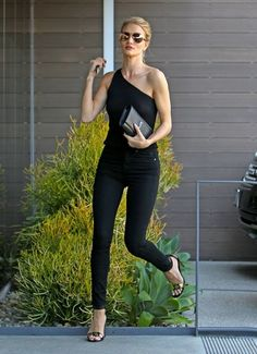 Rosie Huntington-Whiteley Photos - VS Angel Rosie Huntington-Whiteley was spotted stopping by her office in West Hollywood, California on June 2, 2016. She was looking chic with her hair up in a bun and wearing a one-shoulder black top with black jeans. - Rosie Huntington-Whiteley Stops By Her Office In WeHo