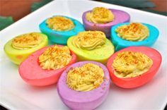 Dyed colored devil eggs... what a cute idea for a party. I wonder if the color would scare anyone off? dyanim