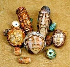 Great faces made using Maureen Carlson's face bead molds.