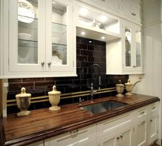 Dark Butcherblock Countertop (with Routed Edge) And White Cabinets (with  Glass Fronts And Lighting)    Ignore The Dark Tile Backsplash.