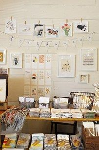 Use clothespins to put up an elegant display of artwork. | 21 Cheap And Easy…