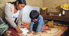 Eduarda is able to help her son, Ismael, with his first-grade homework thanks to a literacy course offered through Compassion's Child Survival Program in Bolivia.