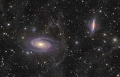 Galaxies M81 and M82, 12 million light years from Earth. | 24 Awe-Inspiring Photos Of Earth And Space