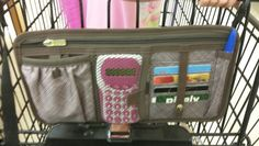 Great coupon organizer!   Made in the Shade pocket by Thirty One.  Attaches right to your shopping cart with snaps so you can keep coupons, calculator, loyalty cards and more at your fingertops!  This also attaches to any Thirty One bag with grommets and has elastic straps that you can use to attach to your car's sun visor!   This comes in Black Cross Pop, Taupe Cross Pop (pictured) and Turquoise Cross Pop.   Another versatile product by Thirty One!