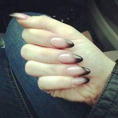 Black ombre stelleto nails.