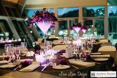 Mixed purples, floral arrangements with purple LED lights for wedding reception held at the Museum of Tropical North Qld.