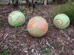 Three balls looking pretty in the garden