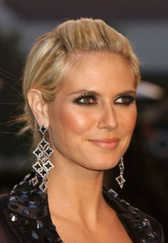 This edgy updo with sexy, kohl-rimmed eyes is a fierce, fashion-forward look for the Project Runway host.