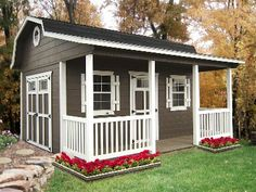 Barn style shed with front porch and railings. I need one so bad for all my junk.
