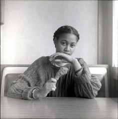 Black Woman With Chicken by Carrie Mae Weems.