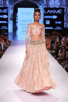 Payal Singhal debuted her latest collection at Lakmé Fashion Week with cream and nude lenghas galore. Spotted prints, peacock dupattas and fringed outfits filled her collection to the brim. She also included small jackets to accessorize her looks. Indian Dresses, Indian Outfits, Indian Clothes, Pakistani Dresses, Off Shoulder Lehenga, Lakme Fashion Week 2015, Lehenga Blouse, Lehenga Choli, Blue Lehenga