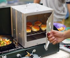 Why cook up homemade biscuits & gravy in your underwear in the kitchen this weekend when you can use Coleman's Camp Oven to make them buck naked in the great outdoors? Set atop a 2- or 3-burner camping stove, the aluminized steel oven will gather and co
