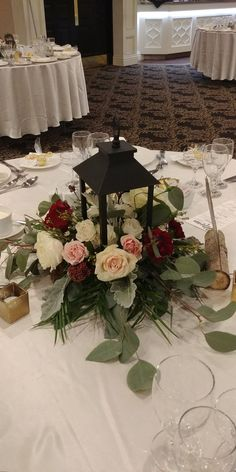 Lantern center piece with blush and burgundy blooms including beautiful garden roses. Florist: blooms studio - New Site Blush Wedding Centerpieces, Lantern Centerpiece Wedding, Wedding Lanterns, Wedding Flower Arrangements, Flower Centerpieces, Floral Arrangements, Wedding Decorations, Table Decorations, Centerpiece Ideas