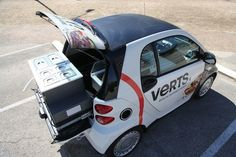 """World's Smallest Food Truck"".....Verts, a doner kebab restaurant in Austin, Texas, has launched a mobile business out of the back of a Smart Car. According to the Austin Business Journal, they worked with German engineers to somehow fit refrigeration units, food warmers, and sinks into the thing. Although to be fair, during service they pop a tent up over the back of it and spread out a little."