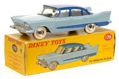 Dinky Toys 178 - Plymouth Plaza. Light blue body, dark blue roof & side flash, chrome spun hubs with white tyres. Near mint (paint chips & grubby tyres) in Good all carded red & yellow picture box (large tear to flap) with correct colour spot.