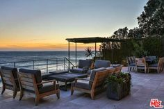 Reminiscent of a modern Italian Palazzo, this beautifully landscaped bluff top masterpiece, with stunning 2-bdrm guesthouse, has beach access by well-maintained steps or private funicular to one of the most desired beach coves.