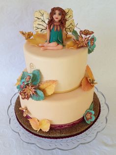 Harvest Fairy Cake.  Made for my niece's 1st birthday, the design was inspired by the fabric of the party dress her mom made for her.  Vanilla Bean cake with strawberry filing and fresh strawberry Swiss meringue buttercream.    The fairy is sculpted out of modeling chocolate.