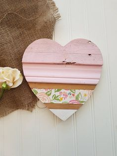 Add a rustic touch to your home with this one of a kind wood heart perfect for a gallery wall, shelf decor or wall decor. Each heart is handmade and made from a unique mixture of materials including reclaimed pallet wood giving you a one of a kind piece for your home. Each piece of