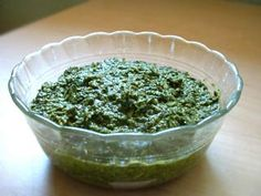 Classic, simple basil pesto recipe with fresh basil leaves, pine nuts, garlic, Romano or Parmesan cheese, extra virgin olive oil, and salt and pepper.