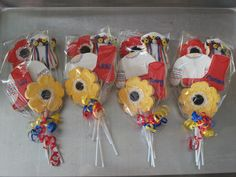 Ukrainian Cookies - vyshyvka, poppies, sunflowers, red dancing boots! We are thinking of doing a Ukrainian theme birthday party........hmmmm.